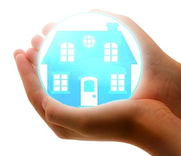 house in bubble in hands representing insurance